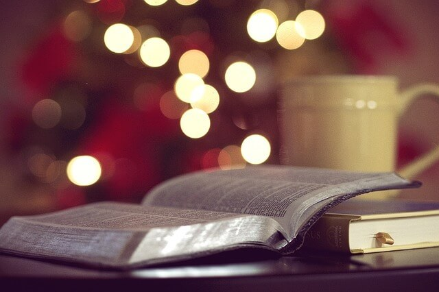 Photo of a Bible in front of Christmas lights | Christmas Bible Quiz