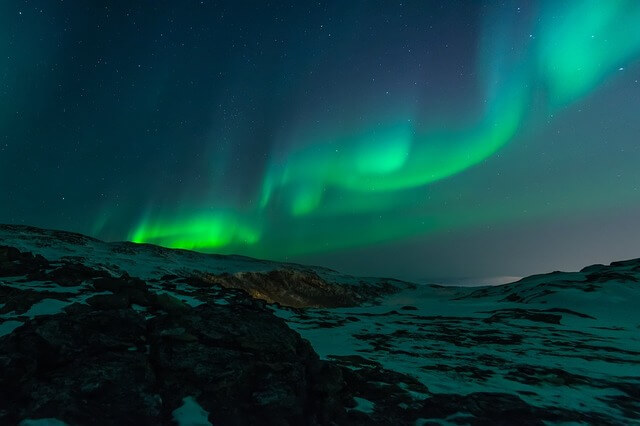 Photo of green northern lights at night | Jesus's miracles bible trivia printable